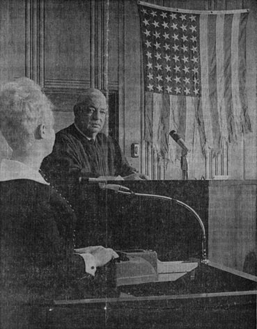 Tattered American flag of LCI 1074 displayed in December 1969 in courtroom of Judge R. G. Harvey
